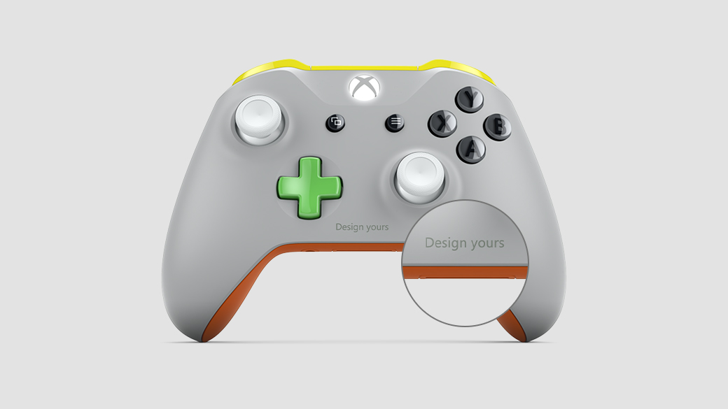 "An Xbox Design Lab controller, featuring a grey front, orange back, and green, black, and white buttons. The words ""design yours"" are engraved on the front."