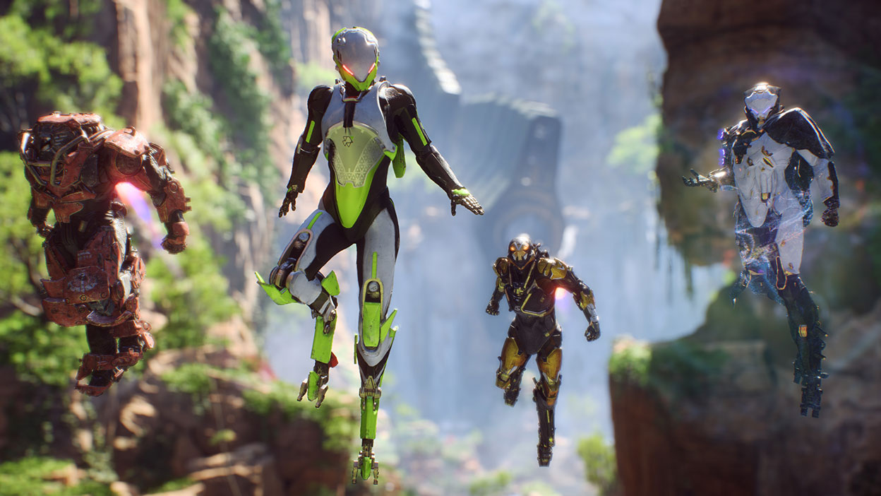 Four different exosuits hover in a canyon