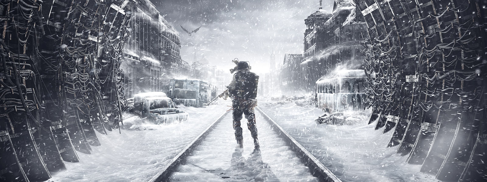 Metro Exodus: a man holding a gun stands on snow-covered tracks in a tunnel