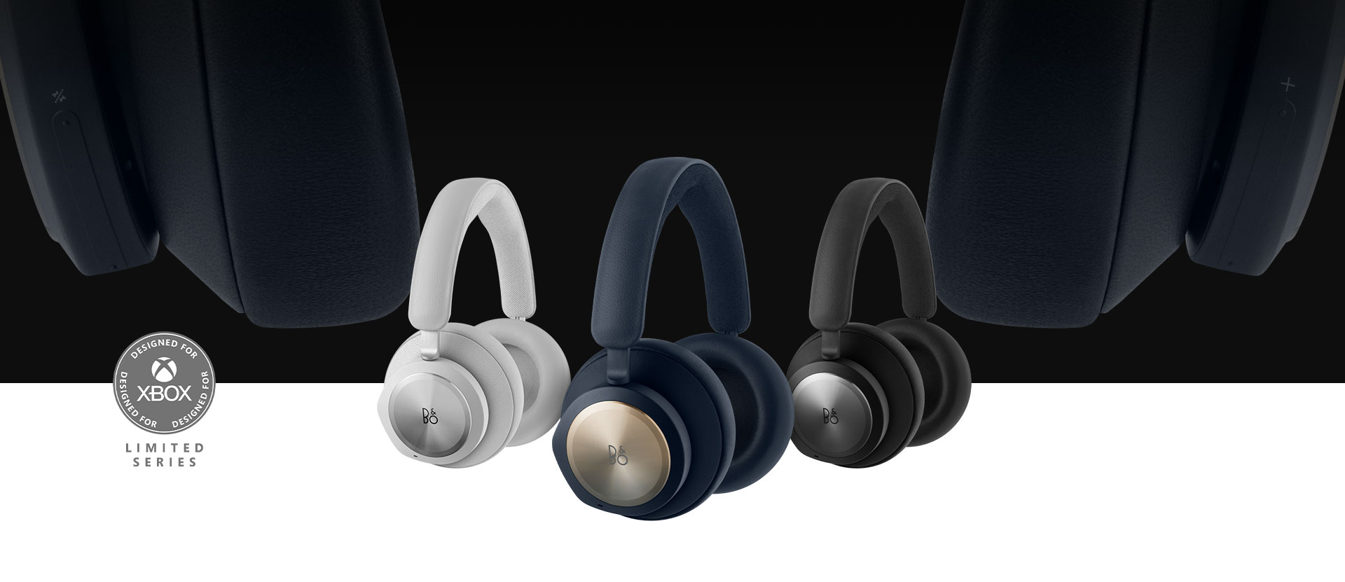 Band and Olufsen navy headset in front with the black and grey headset beside it