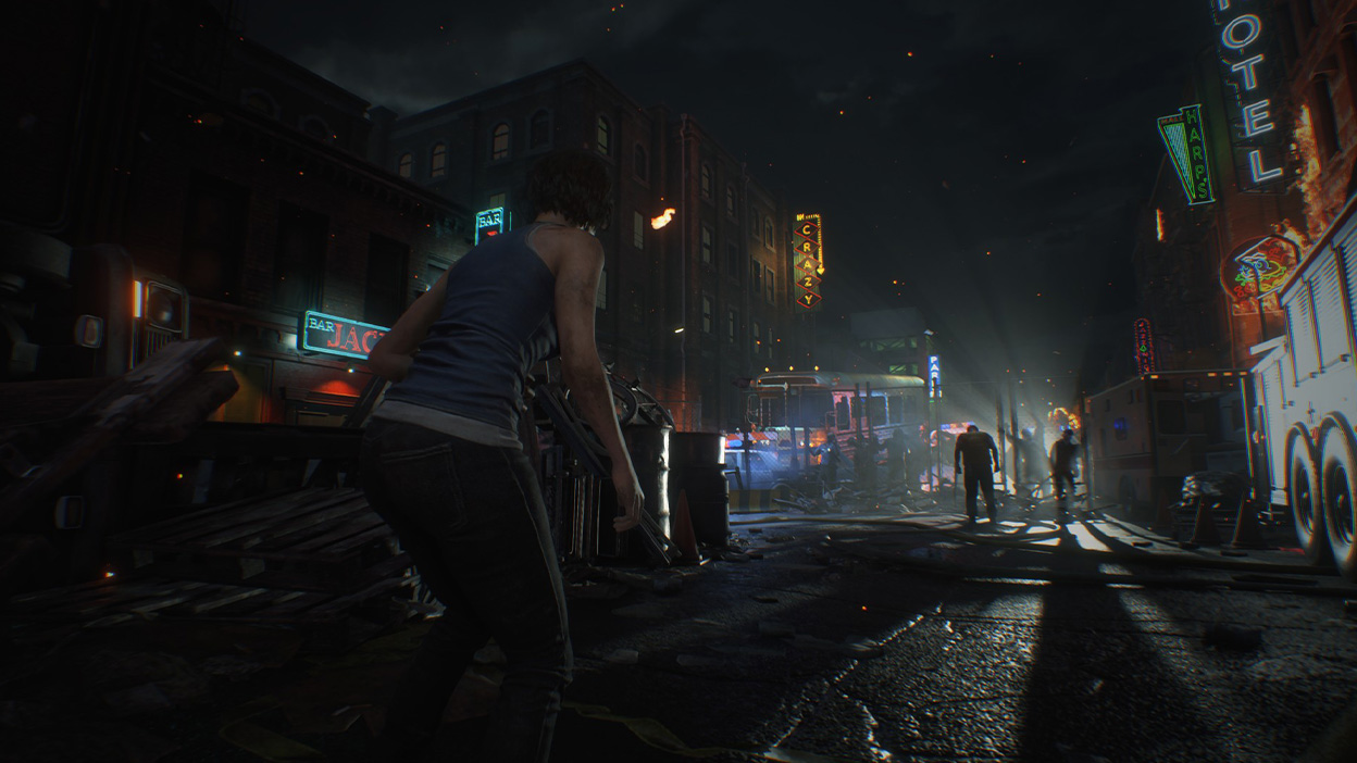 Jill Valentine crouches in the lights of Racoon City at night