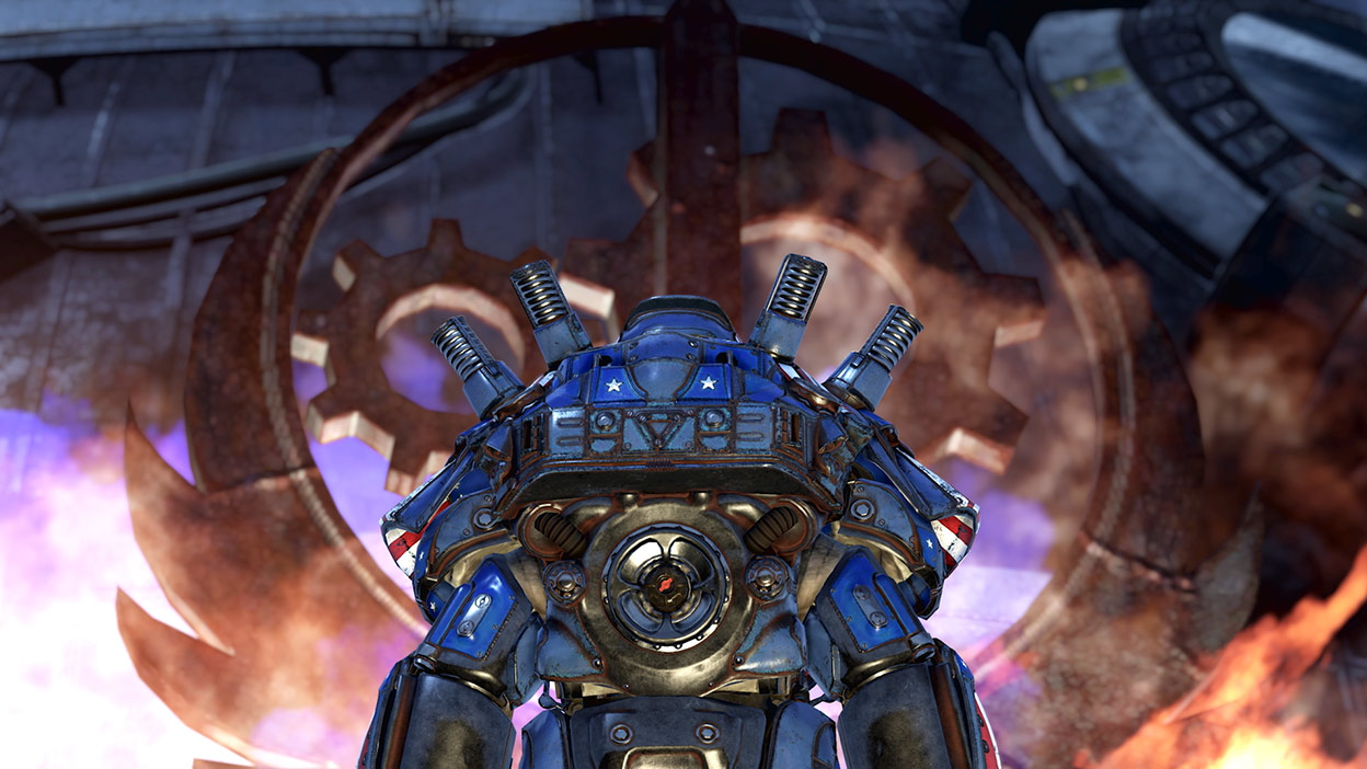 A man in patriotic Power Armor watches while the Brotherhood of Steel symbol burns
